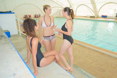 Women beside swimming pool. Women beside the swimming pool Royalty Free Stock Photography
