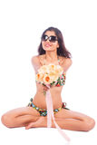 Women Swimming suits with white rose flower Stock Images