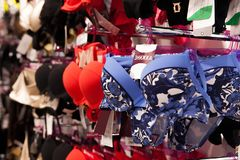 Women swimsuits in the retail store. Fashion shopping concept.  royalty free stock images