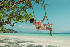 Women and swing at beach. Women play a swing at beach Royalty Free Stock Photos