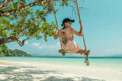 Women and swing at beach. Women play a swing at beach Royalty Free Stock Images