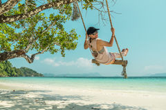 Women and swing at beach. Women play a swing at beach Stock Photo