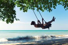 Women on swings Stock Image