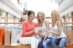 Women with tablet in mall Stock Photo