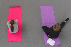 Women take a class at Yoga Festival 2014 in Milan, Italy. MILAN, ITALY - OCTOBER 10: Women take a class at Yoga Festival, event dedicated to yoga, meditation and Stock Photo