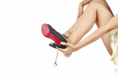 Women take off high heel shoes. Stock Photo
