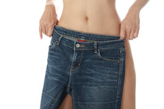 Women take off jeans. Royalty Free Stock Photo
