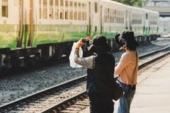 Women take photo of old trains in the train station royalty free stock photos