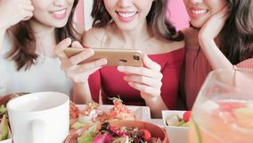 Women take picture in restaurant. Women take picture with food in the restaurant Stock Image