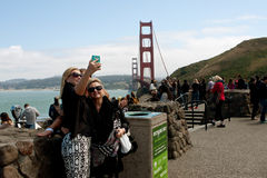 Women Take Selfie With Golden Gate Bridge In Background Stock Photography