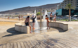 Women take a shower after taking salt bath in the Dead Sea. DEAD SEA, ISRAEL - JUNE 06, 2017: Women take a shower after taking salt bath in the Dead Sea Stock Photos