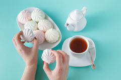 Women take vibrant colored marshmallow for breakfast Stock Photography
