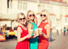 Women with takeaway coffee cups in the city Stock Image
