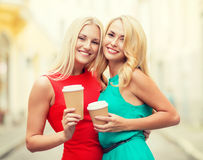 Women with takeaway coffee cups in the city Stock Photo