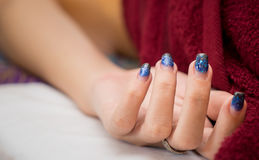 Women is taking Nail Spa. While massaging royalty free stock photo