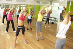 Women Taking Part In Gym Fitness Class Stock Image