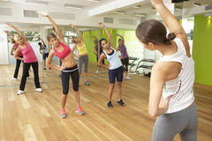 Women Taking Part In Gym Fitness Class Royalty Free Stock Photos
