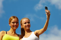 Women taking photo with mobile Royalty Free Stock Photography