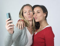 Women taking photo of themselves Stock Photos