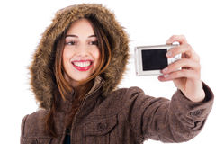 Women taking pic of herself with camera Stock Images