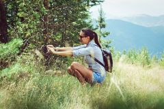 Women taking pictures of a forest and mountain Stock Photo