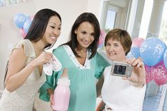 Women Taking Self-Portrait At A Baby Shower Royalty Free Stock Images