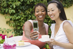 Women Taking Self-Portrait At Dinning Table Royalty Free Stock Image