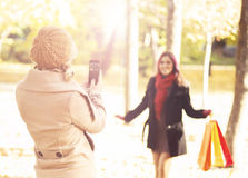 Women taking a selfie in an autumn park Stock Photography