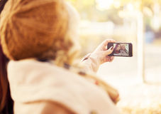 Women taking a selfie in an autumn park Stock Image