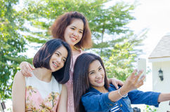 Women taking their photo by smartphone Royalty Free Stock Images