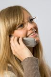 Women talking. Young blonde talking by mobile phone Royalty Free Stock Image
