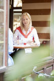 Women talking at coffee shop Stock Photography