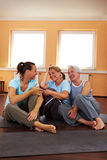 Women talking in gym Stock Images