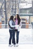 Women talking on icerink Stock Photos