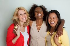 Women talking and laughing. Diverse group of women talking and laughing royalty free stock photos