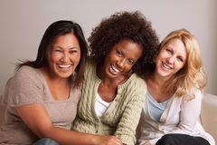 Women talking and laughing. Diverse group of women talking and laughing royalty free stock photo