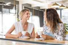 Women talking over coffee Royalty Free Stock Photos