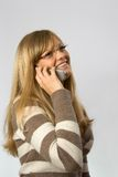 Women talking by phone. Young blonde talking by mobile phone Stock Image