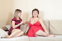 Women talking on sofa Stock Photo