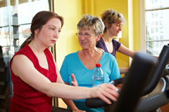 Women talking while spinning. In a gym Stock Photography