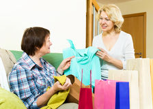 Women talking on their purchases Royalty Free Stock Photography