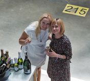 Kyiv Wine Festival by Good Wine in Ukraine. Women taste sparkling wine at Kyiv Wine Festival boothe. 77 winemakers from around the world took part in the big royalty free stock photo