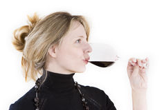 A women tasting a glass of red wine. Against a white background Stock Photos