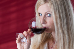 Women tasting red wine. Stock Photos