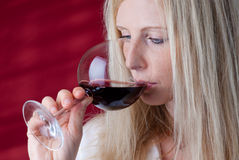 Women tasting red wine. Stock Photography