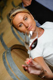 Women tasting wine in a cellar-Winemaker Royalty Free Stock Photo