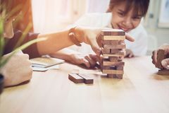 Women and teamwork making a pyramid with empty wooden cubes. Stock Photography