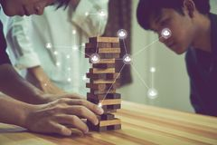 Women and teamwork making a pyramid with empty wooden cubes. stock photo