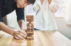 Women and teamwork making a pyramid with empty wooden cubes. royalty free stock photos