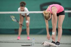 2 women tennis players on court. 2 women tennis players on the court Royalty Free Stock Photography